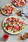 Salad with strawberries, mozzarella and raspberry vinaigrette