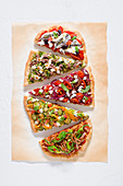 Pizza with five different toppings (top view)