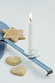 A ladle with a candle and cookies