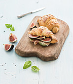 Freshly baked croissants with fresh figs and prosciutto