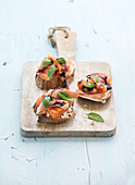 Bruschettas with Prosciutto, roasted melon, soft cheese and basil