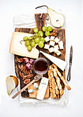 Cheese appetizer set - Various types of cheese, honey, grapes, pear, nuts and bread grissini sticks