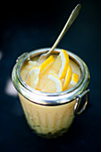 Lemon curd with lemon slices in a jar