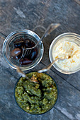 Olives and two dips in jars