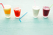 Four quick drinks: ice cream soda, melon shake, ice cream lassi and berry smoothie