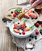 Healthy breakfast - Rice cereal or porridge with berries and honey