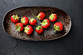 Strawberries in an oval dish (top view)