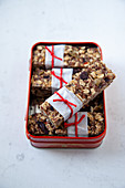 Oatmeal and olive bars in a metal box