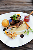 Lamb chops with purée, carrots and vegetable crisps