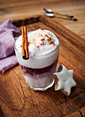 Mulled wine macchiato with milk foam and a cinnamon star
