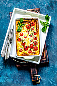 Clafouti with cherry tomatoes on a branch