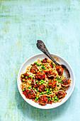 Italian spaghetti with meatballs on a blue surface