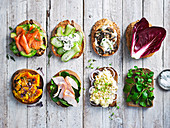 Sandwiches with smoked trout and avocado, mushrooms and labne, chicken and spinach, roasted pumpkin and middle eastern eggs