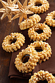 Linz wreath biscuits with chopped almonds and redcurrant jam