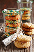 Christmas biscuits with coloured sugar sprinkles in a jar as a gift