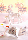 Snowflakes, silver hearts, mushroom and stag as Christmas decorations