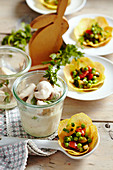 Chicken ragout in a creamy sauce and vegetables in potato baskets for Easter brunch