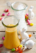 Carrot and orange smoothie with yoghurt and honey for Easter