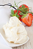 Crème fraîche, strawberries and rosemary