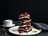 Brownies-cheesecake tower with raspberries