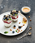 Yogurt oat granola with berries, honey and nuts