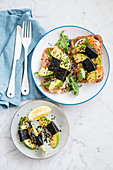 Sandwiches with avocado seaweeds and salmon