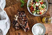 Bistecca: T-bone steak with olive oil and sea salt served with salad (Italy)