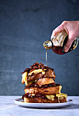 French toast stack with caramelised onions, emmenthal cheese and maple syrup