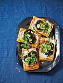 Caramelised onion, goat's cheese and mushroom tarts