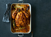 Roast chicken in a roasing tin