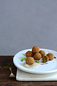 Deep-fried herb matzo balls with tahini sauce