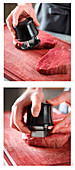Beef steaks being tenderised