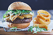Burger with grilled pears and onion rings