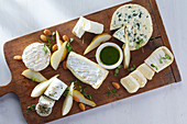 A cheese platter with pears and almonds