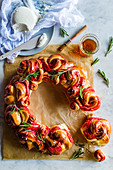 A beetroot bread wreath with rosemary