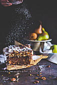 Poudering spices pear and molasses loaf cake with out cake crumble