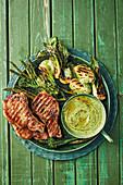 Chargrilled spring greens with lemon pork chops