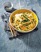 Spaghetti with asparagus, pea and ham carbonara
