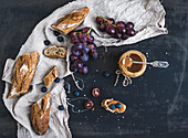 French baguette cut into pieces, red grapes, blueberry and salty caramel sauce
