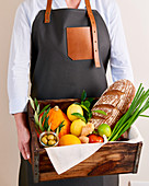 Man holding a case with ingredients