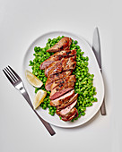 Pan-fried pork fillet with mushy peas