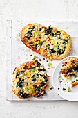 Spinach and cheese pizza