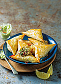 Sardine triangles with avocado dip