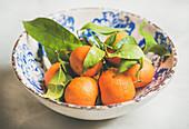 Freshly picked wet ripe mandarines with leaves
