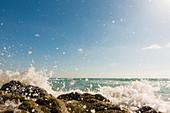 Waves breaking against rocks