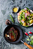 Steak with potato salad