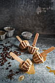 Iced coffee lollies in the shape of little cakes