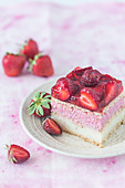 A slice of strawberry vanilla cream fridge cake
