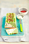 Cream cheese terrine with spinach, courgette and baked red pepper