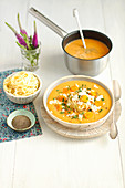 Tomato cream soup with spagheti and feta